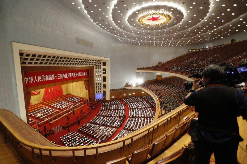 中國擬修改「國防法」,增列「發展利益遭受威脅」。 中新社