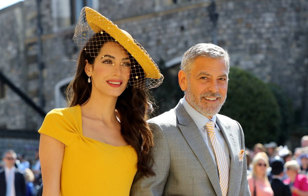 喬治柯隆尼與妻子盛裝出席英國皇室婚禮,理由卻很離譜。圖/路透資料照片