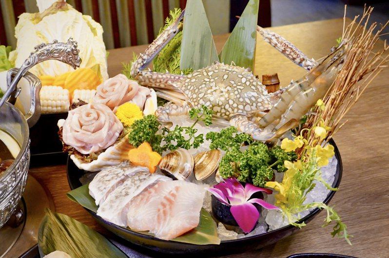 凡滿足活動條件,即可獲贈價值1,111元的海鮮拼盤。圖/問鼎提供
