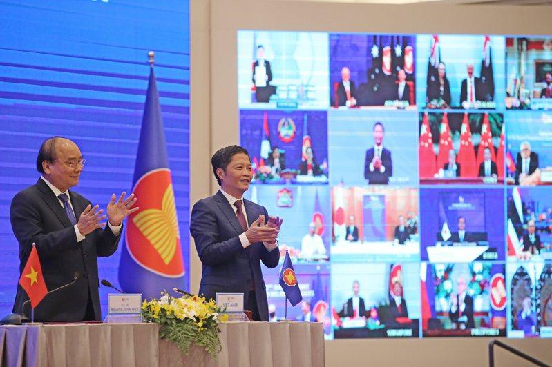 中國、日本、澳洲等亞太國家15日簽署「區域全面經濟夥伴協定」(RCEP),將組成世界最大自貿區。圖/歐新社