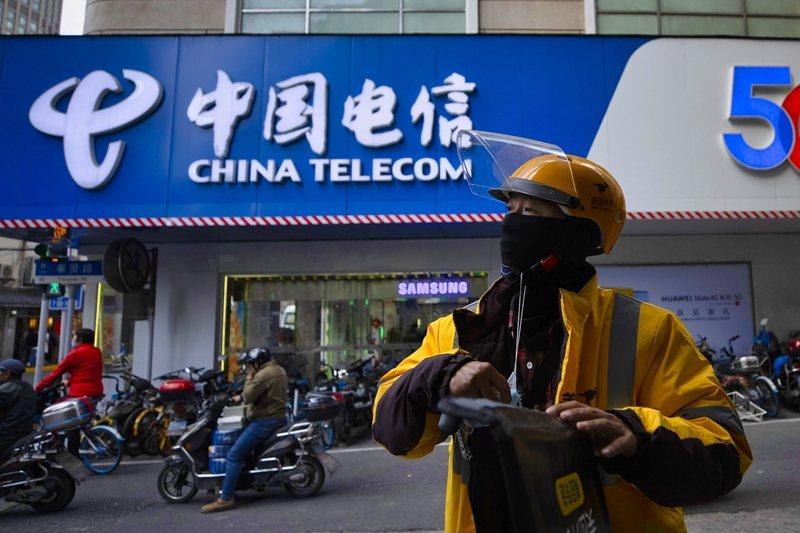 此令發布後影響明顯,例如透過美國存托憑證(ADR)在美國市場交易的中國電信股價一度重挫。 圖/歐新社