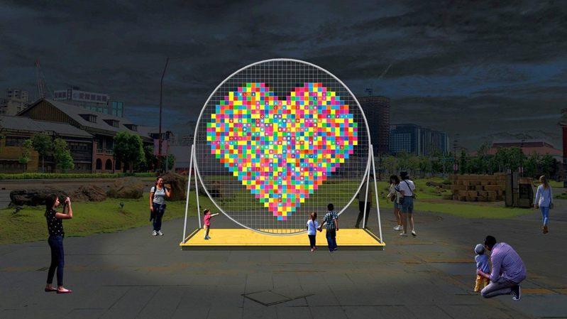 北門廣場巨型愛心裝置「超集愛」以色彩繽紛的透明壓克力片排成愛心形狀,象徵圓滿幸福。 圖/觀傳局