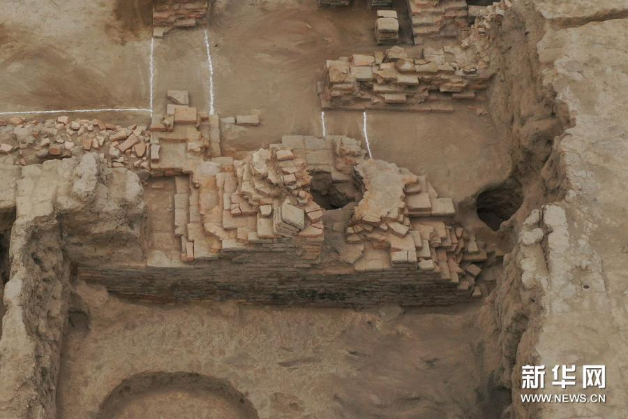 新疆唐朝墩古城浴場遺址北側的灶址結構。新華網