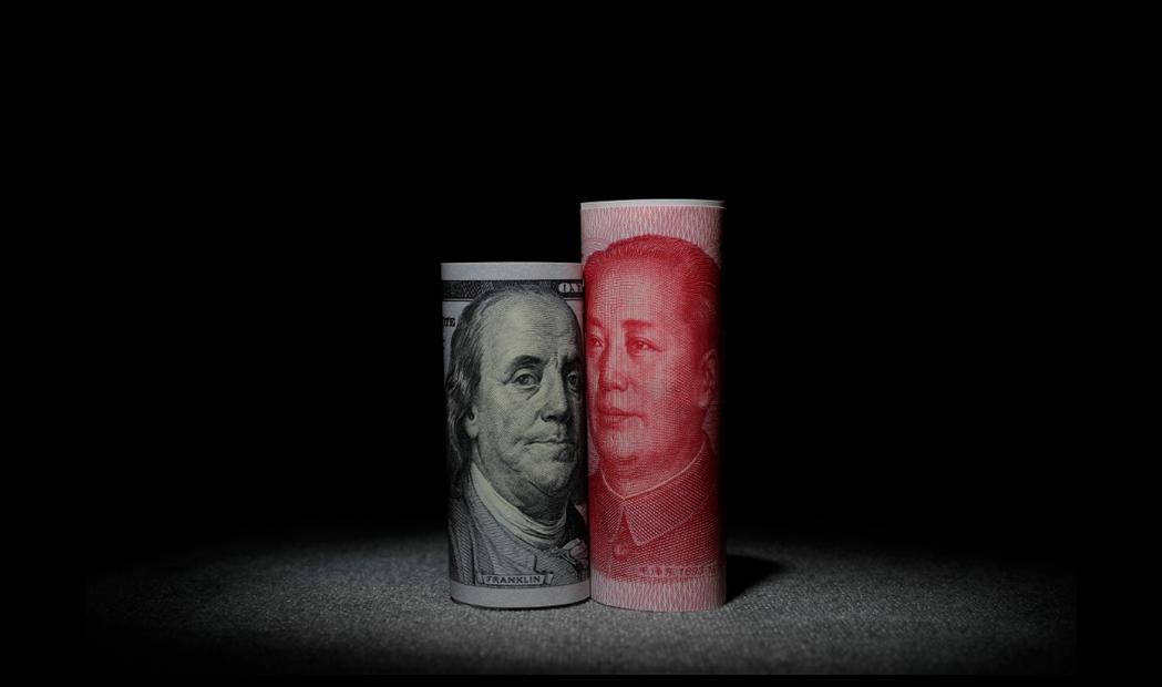 人民幣對美元中間價25日上調60個基點。歐新社