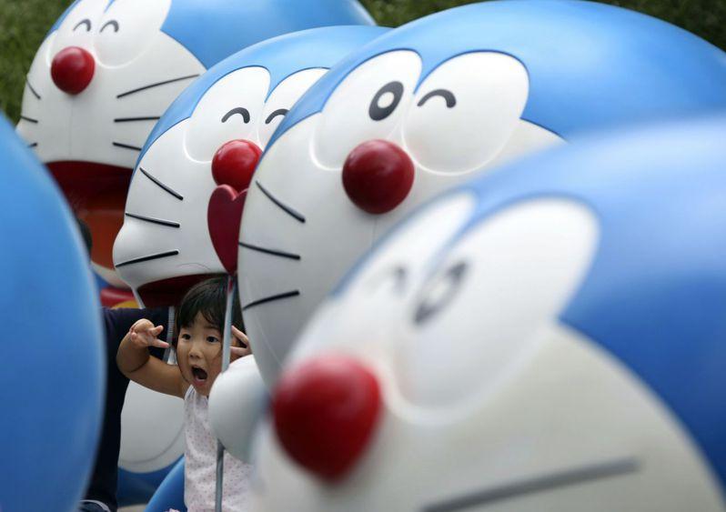 《哆啦A夢》系列漫畫出版至今已滿50周年,仍深受小朋友喜愛。美聯社
