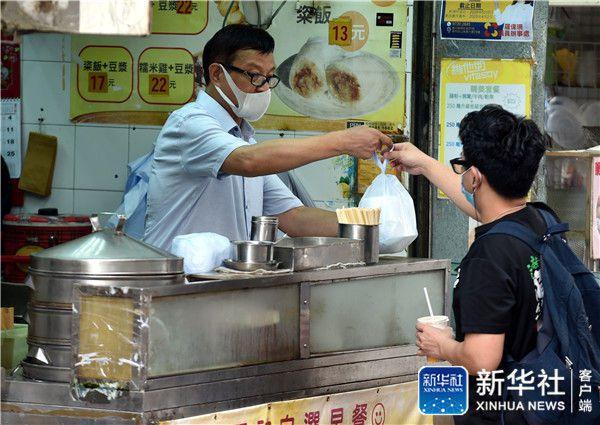 截至29日0時,香港新增115例新冠肺炎確診個案。(圖/取自新華社)