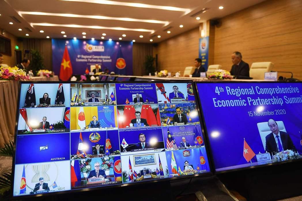 11月15日簽署的RCEP,是涵蓋東協十國加上日、韓、中、澳、紐的15國經濟協議。 圖/法新社