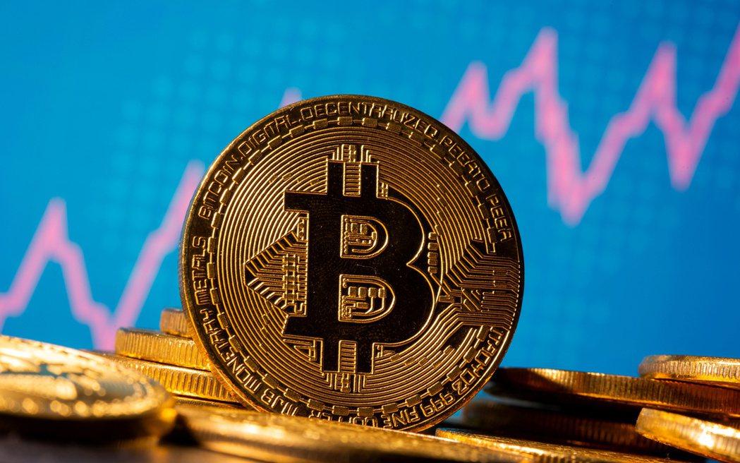 比特幣(bitcoin)在11月的最後一天改寫歷史新高。  路透