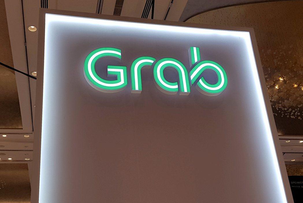 知情人士說,東南亞叫車平台Grab可望與Gojek聯姻。路透