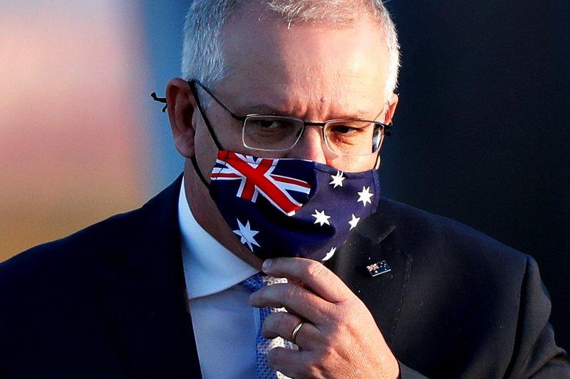 澳洲總理莫里森於記者會譴責趙立堅對澳洲軍方與國旗的羞辱是「令人厭惡的詆毀」。 圖/路透社