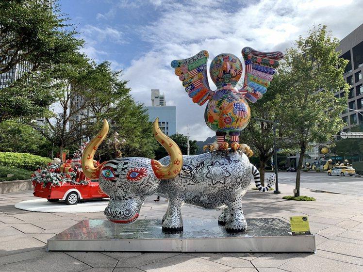 辦公大樓結合公園花藝佈置、台灣中生代藝術家洪易的雕塑作品,打造出「LOVE PA...