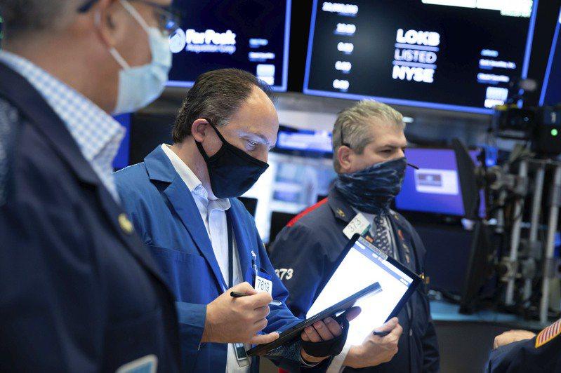 投资人担心美国新冠肺炎确诊数不断升高,美国股市7日早盘下跌。  美联社(photo:UDN)