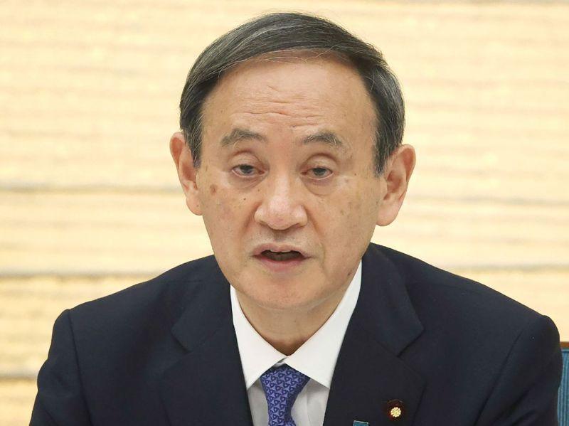 日本首相菅義偉14日在首相官邸主持會議。法新社