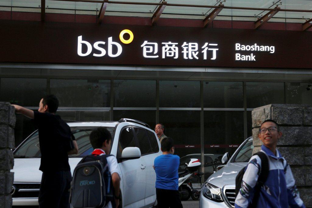 包商銀行債務全面減記以及明天系被接管等事件,已經再度敲響中國金融風暴之警鐘。 圖/路透社