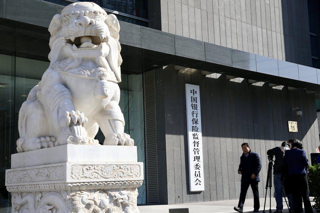 2019年5月24日,中國人民銀行、中國銀保監會對包商銀行實施接管,接管期間經清產核資,確認包商銀行嚴重資不抵債。 圖/路透社
