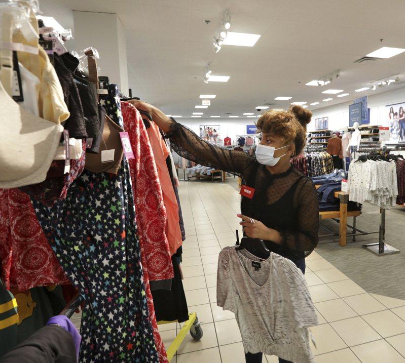 美国11月零售销售下滑1.1%,且10月零售销售也下修为减少0.1%。美联社(photo:UDN)