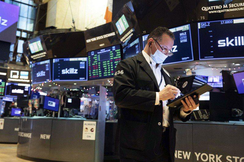 美股早盘走高,美国总统川普扬言可能不签国会通过的疫情纾困案,但无损投资人信心。美联社(photo:UDN)