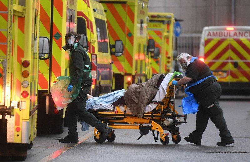 英國新冠病毒疫情仍持續延燒。 歐新社