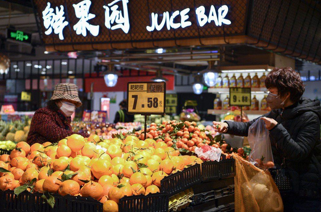 2021年中共進入「十四五計畫」,並加緊「中國經濟形勢看好」的官方宣傳。 圖/新華社