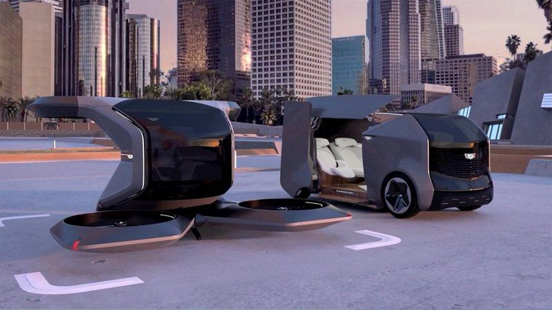 美國通用汽車(GM)12日在消費性電子展(CES)發表兩款未來感十足的凱迪拉克概念車,包括全自主電動垂直起降飛天車(左)與家庭友善型電動旅行車(右)。路透/GM