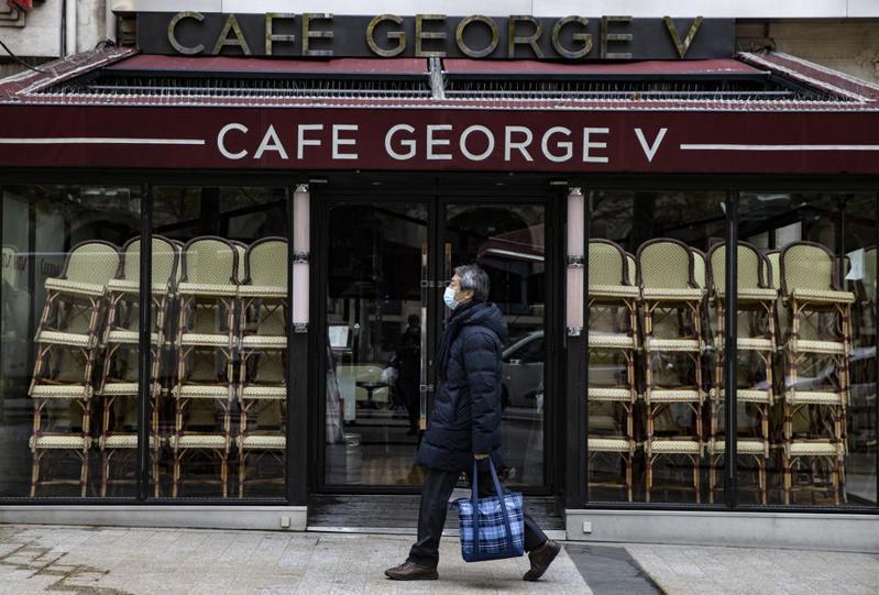 圖為香榭麗舍大道上知名的咖啡店。歐新社