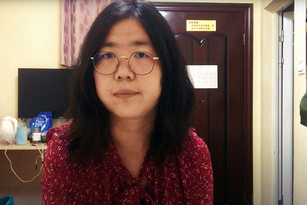 被捕的中國公民記者張展。圖/法新社