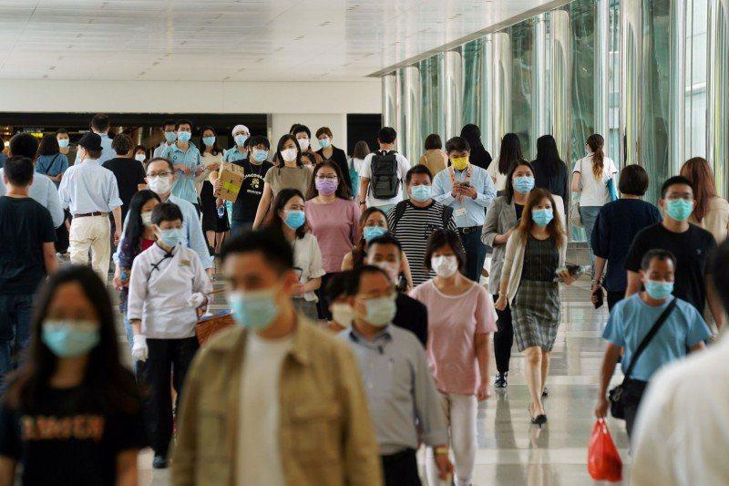 香港疫情持續。路透社