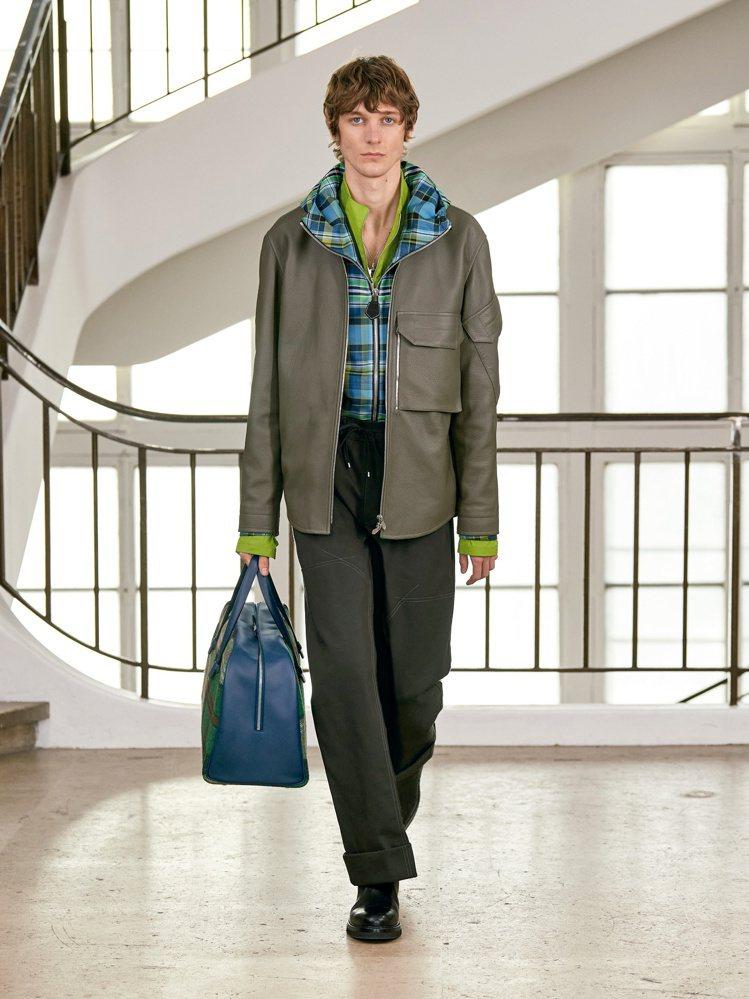 不同材質、印花的夾克或襯衫疊穿,也富含獨特創意,當中也使用了一些表層防潑水科技材...