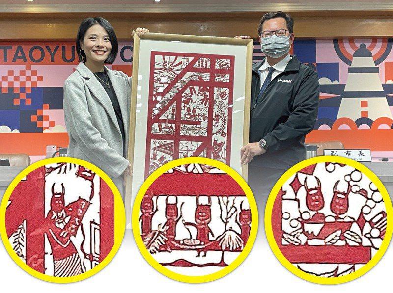 桃園市政府的紙雕春聯,「牛頭」圖騰設計與場景引發部分市民抱怨。記者張裕珍/攝影