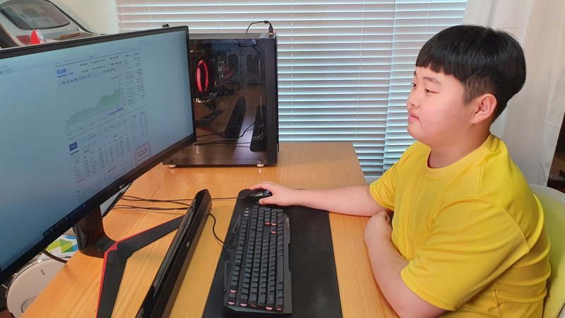 南韩12岁男童权俊去年靠着投资股票,获利43%。  路透(photo:UDN)