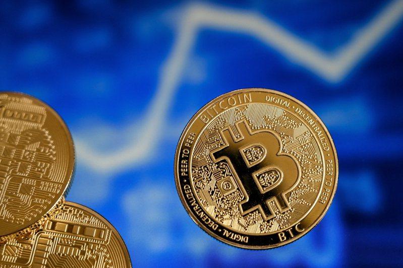 比特幣17日首次站上5.2萬美元。  歐新社