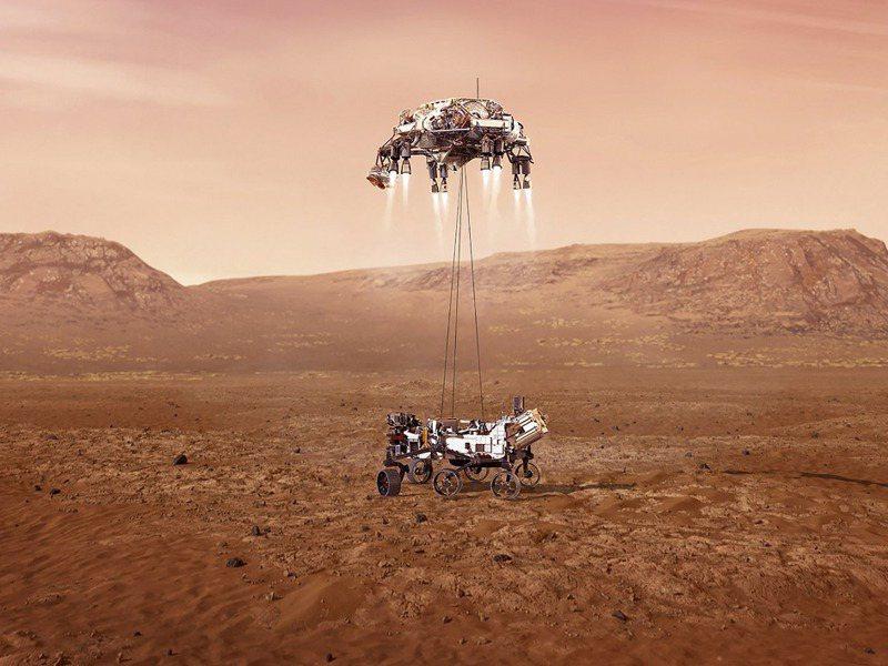 噴射背包啟動「空中吊車」,將毅力號探測車垂降至火星地面。法新社/NASA/JPL-Caltech