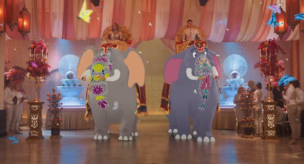 柯林約斯特(右)在「湯姆貓與傑利鼠」中騎著卡通大象結婚。圖/摘自YouTube
