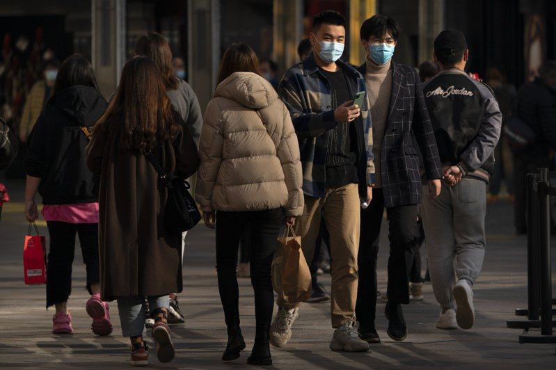 中國21日新增11例新冠肺炎確診者。 美聯社