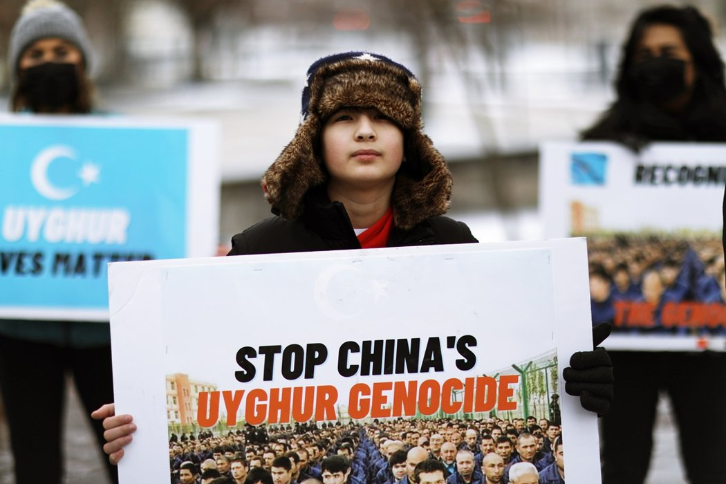 On February 21st, protesters outside the parliament in Ottawa called on the government to recognize China's genocide of Uyghurs. Figure / Reuters...
