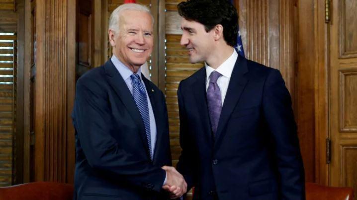 圖為美國總統拜登(左)與加拿大總理杜魯道(右)。 路透