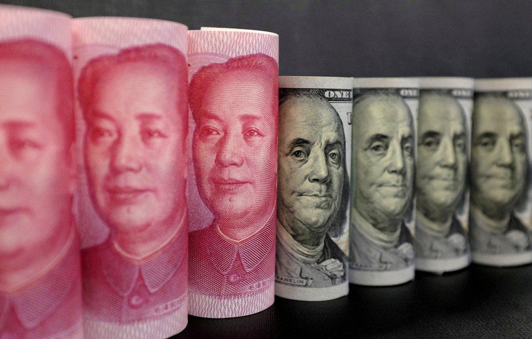 人民幣對美元去年升值達6.6%,大陸學者警告,應警惕人民幣遭精準設計與操縱下的「...