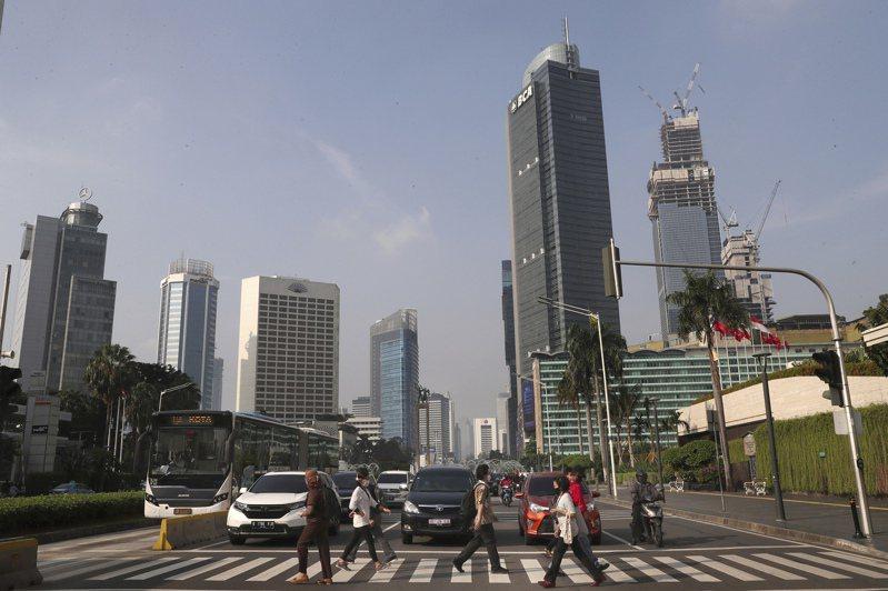 亚洲新兴经济体的央行外汇存底去年增加4,677亿美元,增额为2013年以来最大。美联社(photo:UDN)