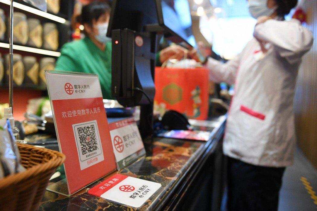 北京商店設有數位人民幣試點。  圖/新華社