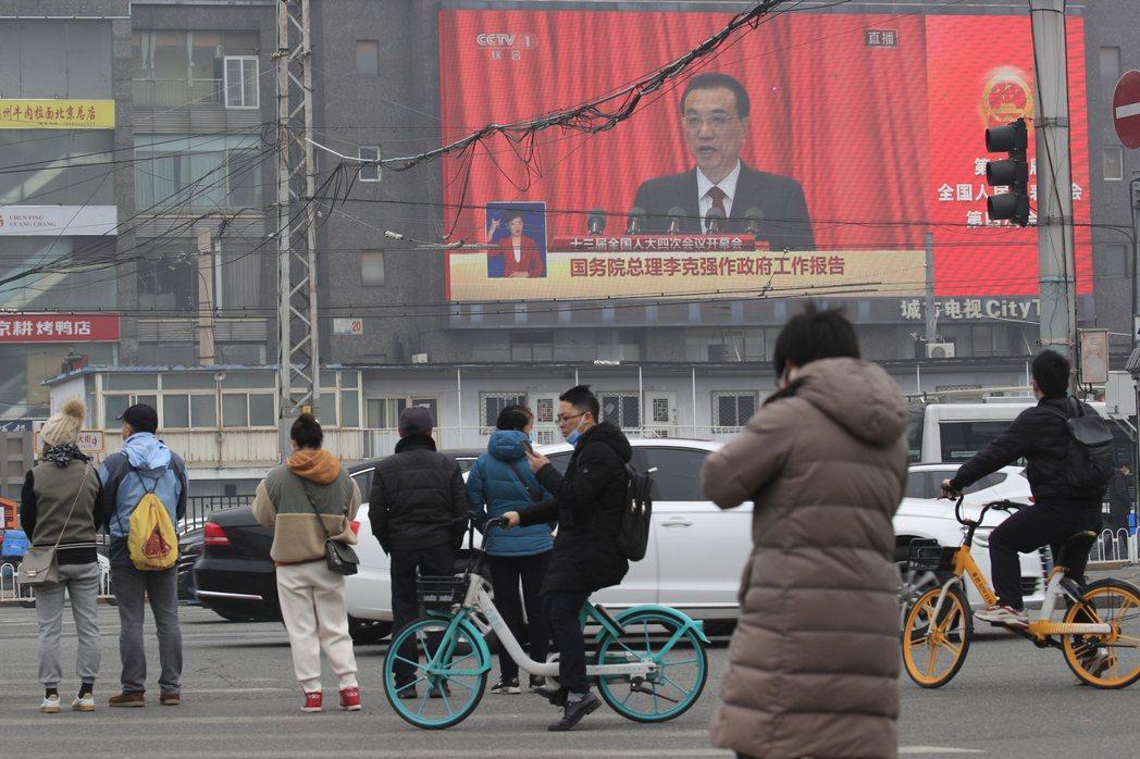 大陸台籍兩會代表委員認為,李克強今年政府工作報告涉台部份的表述,顯示北京當局對台...