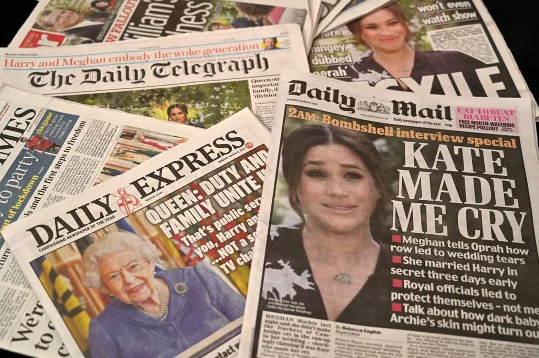 英國各家媒體8日紛以頭版刊登哈利王子和梅根的專訪內容。法新社