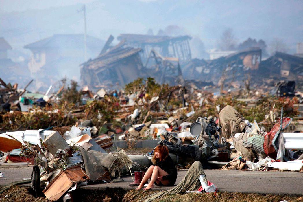 圖攝於2011年3月13日,大地震發生後兩天的宮城縣名取市。 圖/路透社