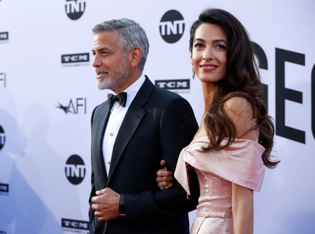 喬治柯隆尼(左)的妻子艾莫,據傳擔心他拍片會跟女主角擦出愛的火花。圖/路透資料照
