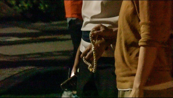 陪跑員利用繩子帶領視障者跑步。 圖/劉宥均攝影