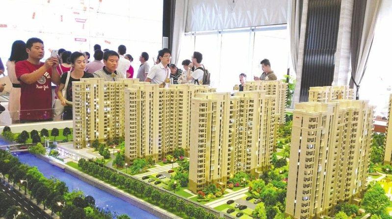 上海、深圳、杭州等大陸多地的房地產仲介行業協會最近相繼發聲,嚴禁「炒房」。圖/取自搜狐