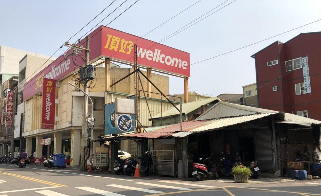 嘉義市區老透天連同11筆土地,以總價1.6億成交。圖/台灣房屋提供