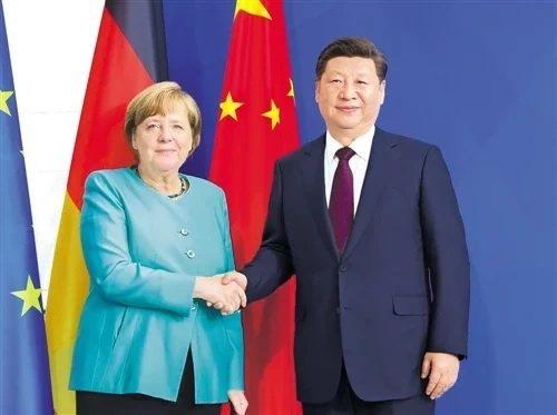 德國總理梅克爾(左)與大陸國家主席習近平(右)。圖/取自新華社