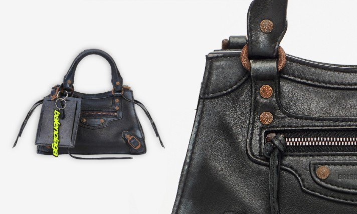 Balenciaga Neo Classic Used的小牛皮包身和金屬五金配件...