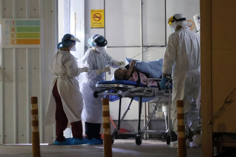 新冠肺炎疫情嚴峻,圖為篩檢站示意圖,非新聞當事人。記者許正宏攝影/報系資料照