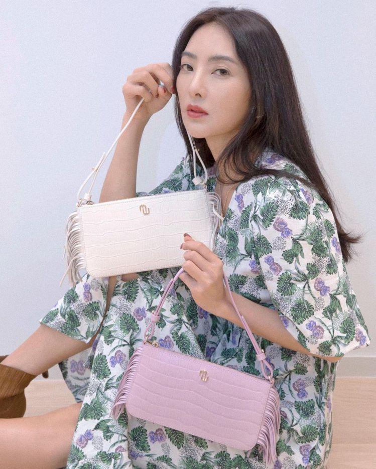吳速玲身穿maje洋裝13,680元,搭配Stick Bag系列包款。圖/取自I...